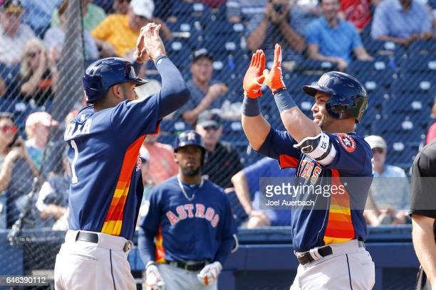 Carlos Correa congratulates Carlos Beltran of the Houston Astros after he hit a two run home run against the Washington Nationals in the fourth...