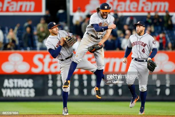 Carlos Correa Jake Marisnick and George Springer of the Houston Astros celebrate after defeating the New York Yankees at Yankee Stadium on May 11...