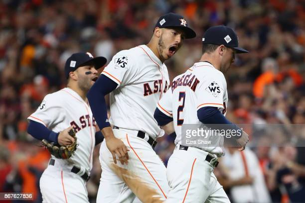 Carlos Correa Jose Altuve and Alex Bregman of the Houston Astros celebrate during the sixth inning against the Los Angeles Dodgers in game four of...