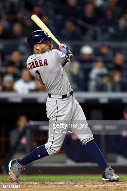 Carlos Correa of the Houston Astros bats during Game 3 of the American League Championship Series against the New York Yankees at Yankee Stadium on...