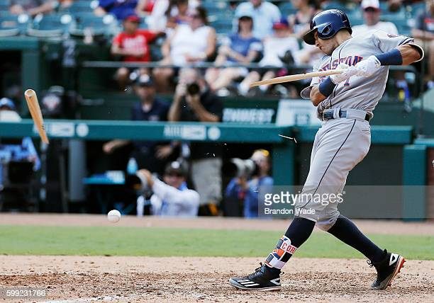 Carlos Correa of the Houston Astros breaks his bat in the sixth inning of a baseball game against the Texas Rangers at Globe Life Park in Arlington...
