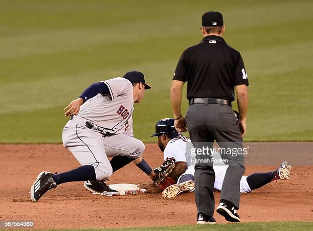 Carlos Correa of the Houston Astros catches Danny Santana of the Minnesota Twins stealing second base as umpire Mark Wegner looks on during the fifth...