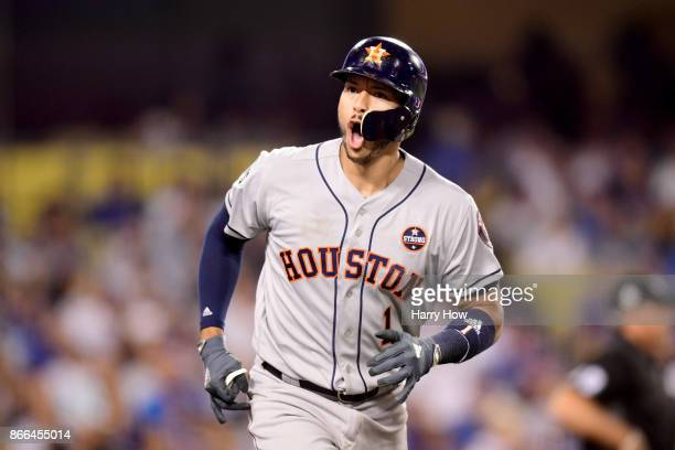 Carlos Correa of the Houston Astros celebrates after hitting a solo home run during the tenth inning against the Los Angeles Dodgers in game two of...