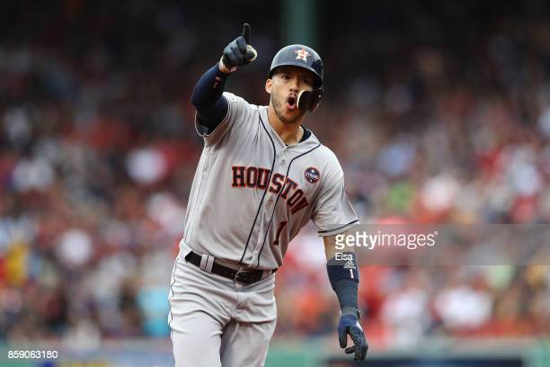 Carlos Correa of the Houston Astros celebrates as he runs the bases after hitting a tworun home run in the first inning against the Boston Red Sox...
