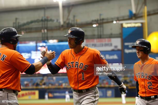 Carlos Correa of the Houston Astros celebrates his tworun home run with teammates Carlos Beltran and Alex Bregman during the third inning of a game...
