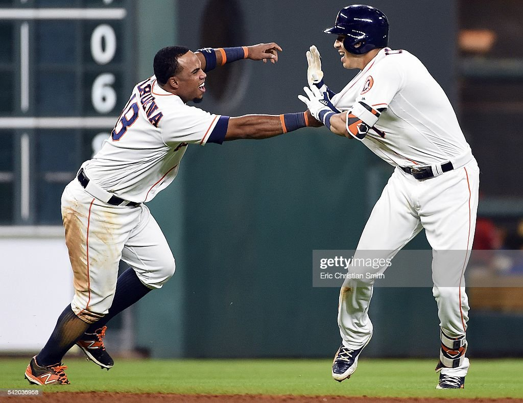 Carlos Correa #1 of the Houston Astros (R) celebrates his two-run, walk-off single with Luis Valbuena during the ninth inning against the Los Angeles Angels of Anaheim at Minute Maid Park on June 21, 2016 in Houston, Texas. Houston won 3-2.