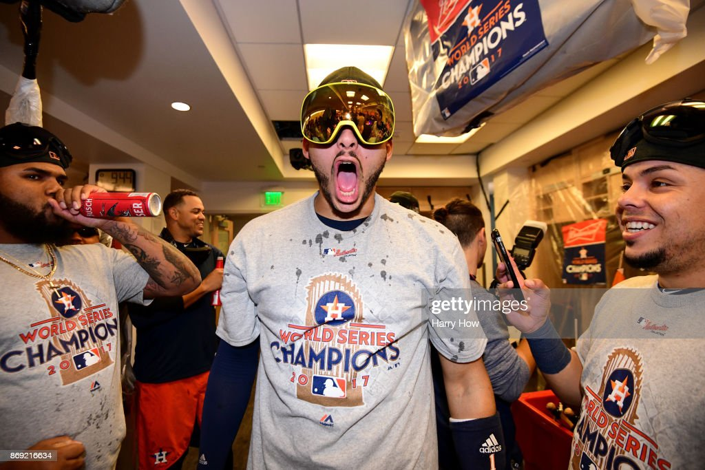 Carlos Correa #1 of the Houston Astros celebrates in the clubhouse after defeating the Los Angeles Dodgers 5-1 in game seven to win the 2017 World Series at Dodger Stadium on November 1, 2017 in Los Angeles, California.