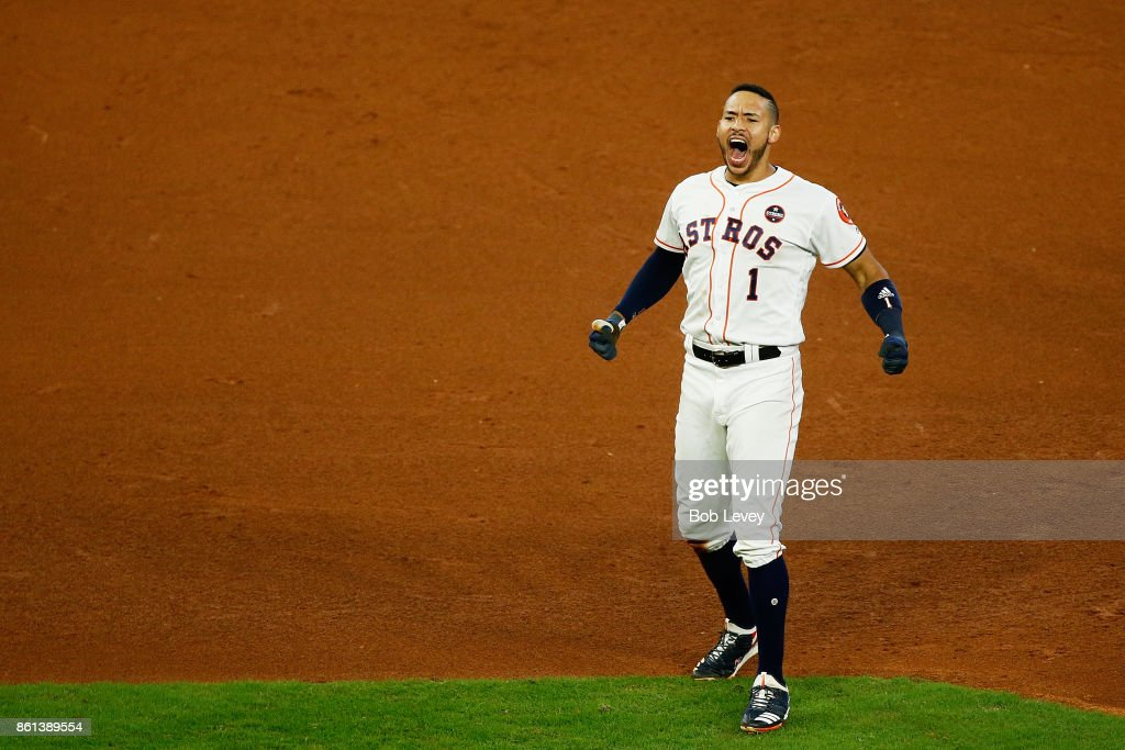 Carlos Correa #1 of the Houston Astros celebrates their 2 to 1 win over the New York Yankees in game two of the American League Championship Series at Minute Maid Park on October 14, 2017 in Houston, Texas.