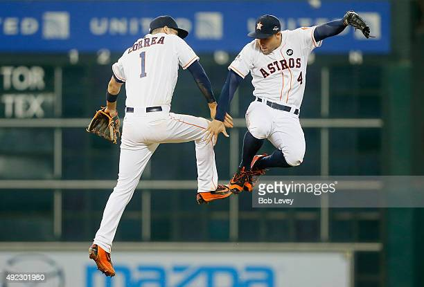 Carlos Correa of the Houston Astros celebrates with George Springer of the Houston Astros after the Houston Astros defeat the Kansas City Royals in...