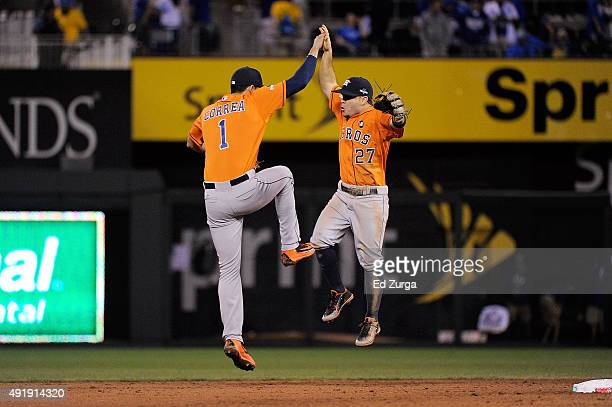 Carlos Correa of the Houston Astros celebrates with Jose Altuve of the Houston Astros after defeating the Kansas City Royals in game one of the...