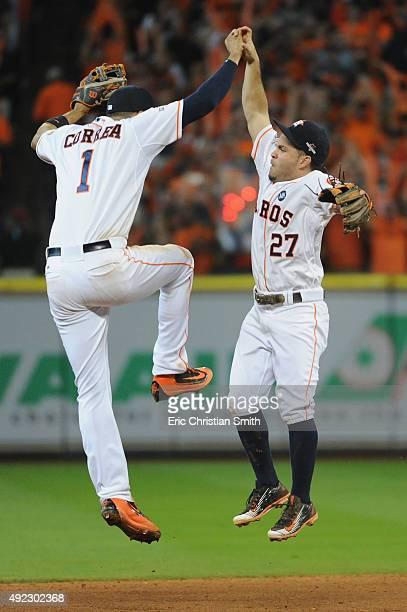 Carlos Correa of the Houston Astros celebrates with Jose Altuve of the Houston Astros after the Houston Astros defeat the Kansas City Royals in game...