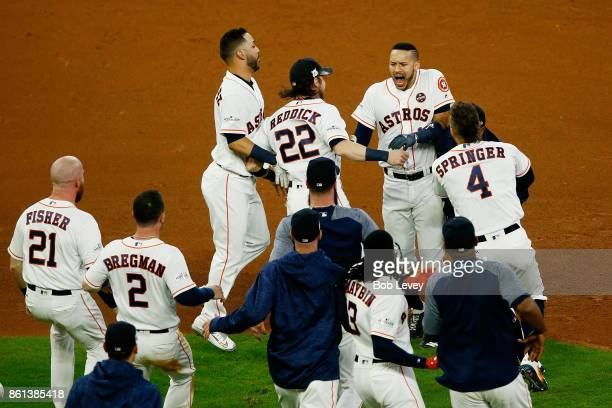 Carlos Correa of the Houston Astros celebrates with teammates after their 2 to 1 win over the New York Yankees in game two of the American League...