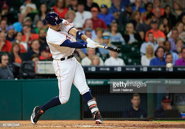 Carlos Correa of the Houston Astros connects on a tworun double in the third inning of their game against the Minnesota Twins at Minute Maid Park on...