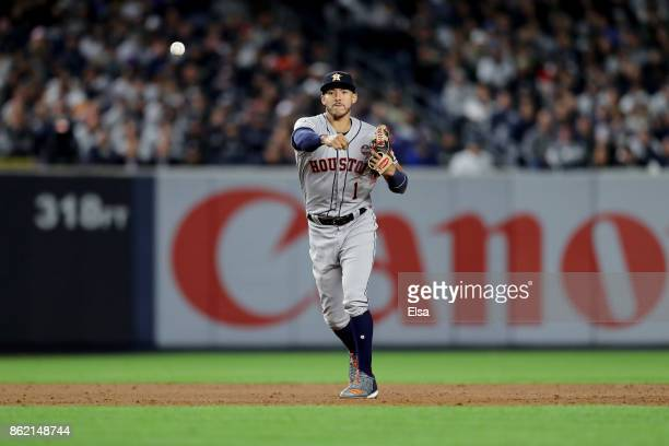 Carlos Correa of the Houston Astros fields a hits a by Gary Sanchez of the New York Yankees during the fifth inning in Game Three of the American...