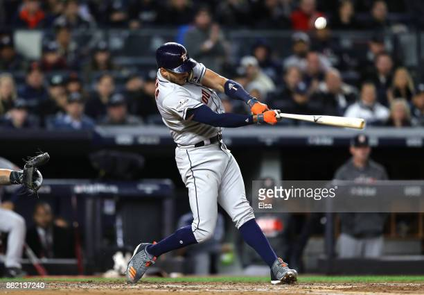 Carlos Correa of the Houston Astros flies out during the third inning against the New York Yankees in Game Three of the American League Championship...