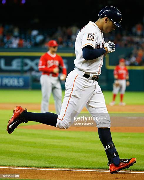 Carlos Correa of the Houston Astros heads home after hitting a solo home run off CJ Wilson of the Los Angeles Angels of Anaheim in the first inning...