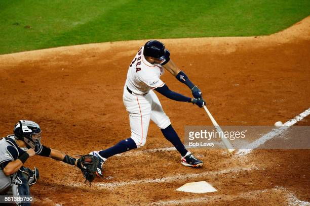 Carlos Correa of the Houston Astros hits a double in the ninth inning scoring Jose Altuve to win game two of the American League Championship Series...