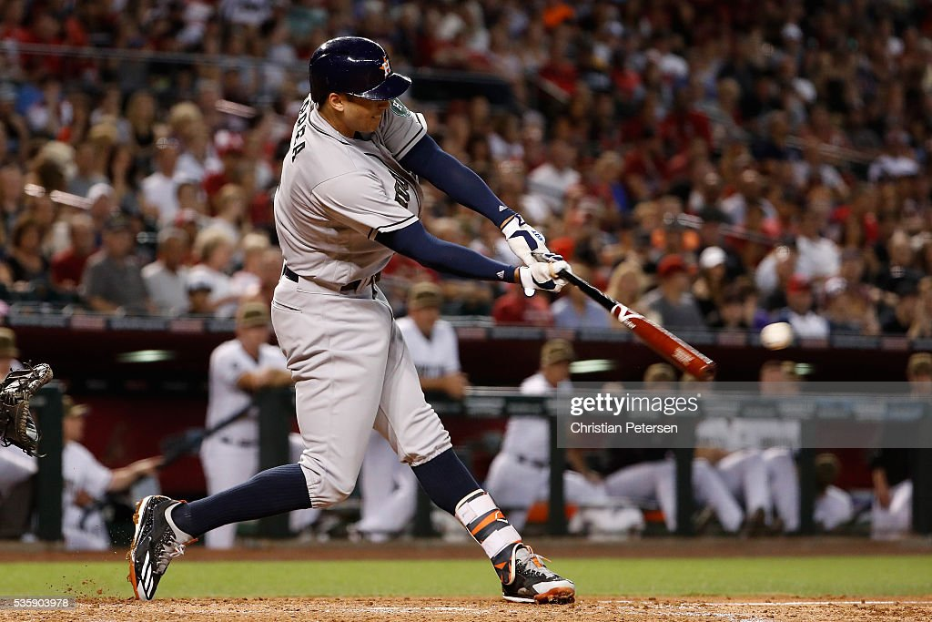 <a gi-track='captionPersonalityLinkClicked' href=/galleries/search?phrase=Carlos+Correa+-+Baseball+Player&family=editorial&specificpeople=11452157 ng-click='$event.stopPropagation()'>Carlos Correa</a> #1 of the Houston Astros hits a RBI single against the Arizona Diamondbacks during the second inning of the MLB game at Chase Field on May 30, 2016 in Phoenix, Arizona.