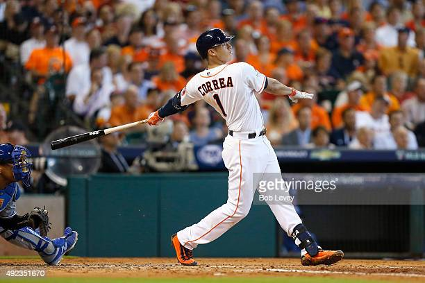 Carlos Correa of the Houston Astros hits a solo home run to tie the game in the third inning against the Kansas City Royals during game four of the...