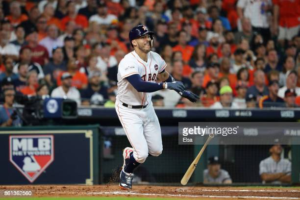 Carlos Correa of the Houston Astros hits a solo homerun in the fourth inning against the New York Yankees during game two of the American League...