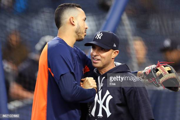 Carlos Correa of the Houston Astros hugs Joe Espada of the New York Yankees before Game Three of the American League Championship Series at Yankee...