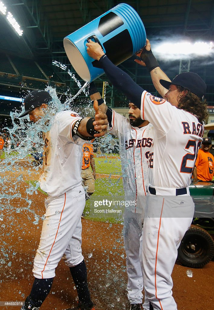 Carlos Correa of the Houston Astros is showered with Powerade by teammates Marwin Gonzalez and Colby Rasmus after Correa drove in the game winning...