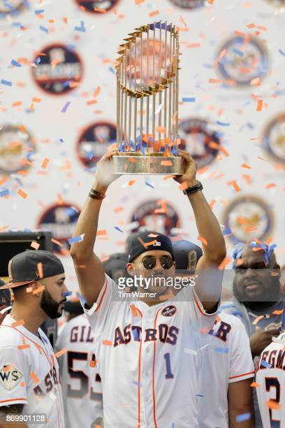 Carlos Correa of the Houston Astros lifts the World Series Trophy during the Houston Astros Victory Parade on November 3 2017 in Houston Texas The...