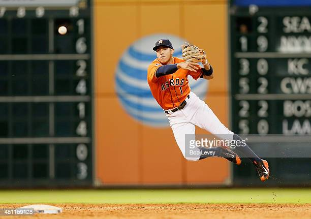 Carlos Correa of the Houston Astros makes a diving throw to retire Prince Fielder of the Texas Rangers in the ninth inning at Minute Maid Park on...