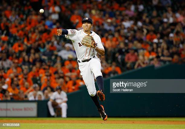 Carlos Correa of the Houston Astros makes a play in the infield in the fourth inning during their game against the New York Yankees at Minute Maid...
