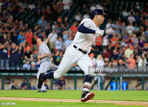 Carlos Correa of the Houston Astros reaches base on a tworun double in the third inning of their game against the Minnesota Twins at Minute Maid Park...