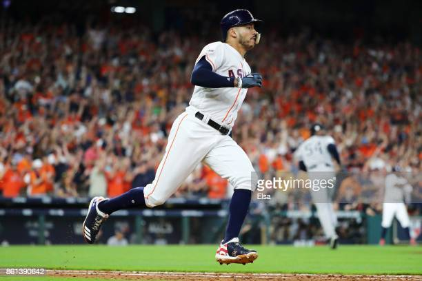 Carlos Correa of the Houston Astros runs to first on his double in the ninth inning scoring Jose Altuve of the Houston Astros to defeat the New York...