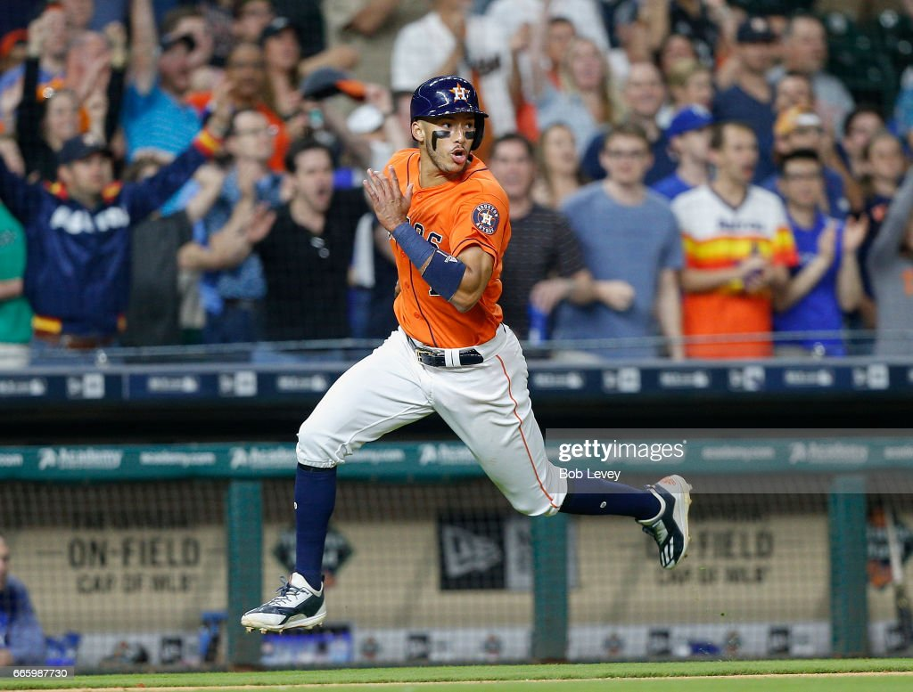 Carlos Correa #1 of the Houston Astros scores in the seventh inning on a double by Carlos Beltran #15 against the Kansas City Royals at Minute Maid Park on April 7, 2017 in Houston, Texas.