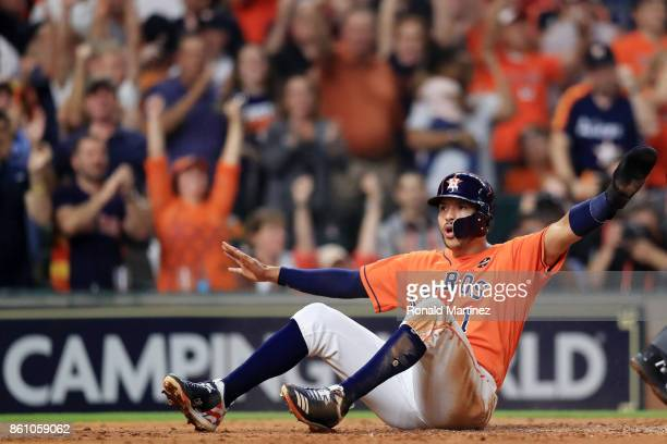Carlos Correa of the Houston Astros scores on a single by Yuli Gurriel in the fourth inning during game one of the American League Championship...