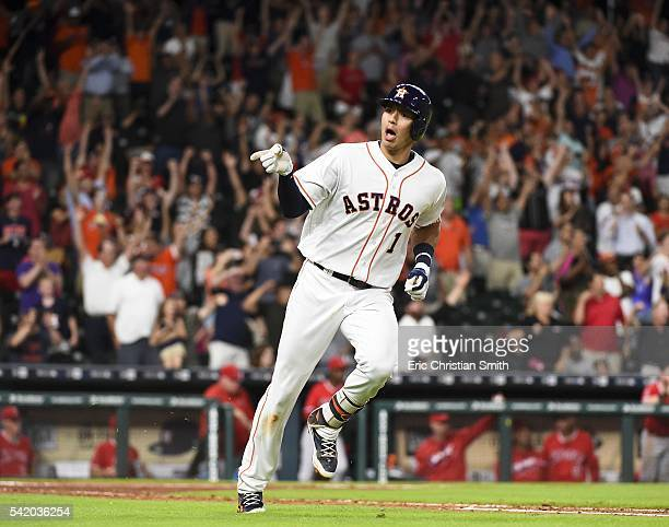 Carlos Correa of the Houston Astros signals to the Astros' dugout after hitting a tworun walk off single during the ninth inning against the Los...