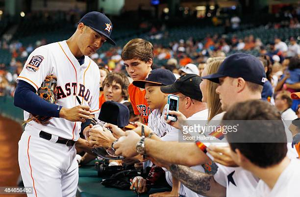 Carlos Correa of the Houston Astros signs autographs for fans before their game against the Tampa Bay Rays at Minute Maid Park on August 20 2015 in...