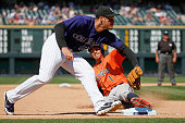 Carlos Correa of the Houston Astros steals third base as third baseman Nolan Arenado of the Colorado Rockies takes the late throw in the seventh...