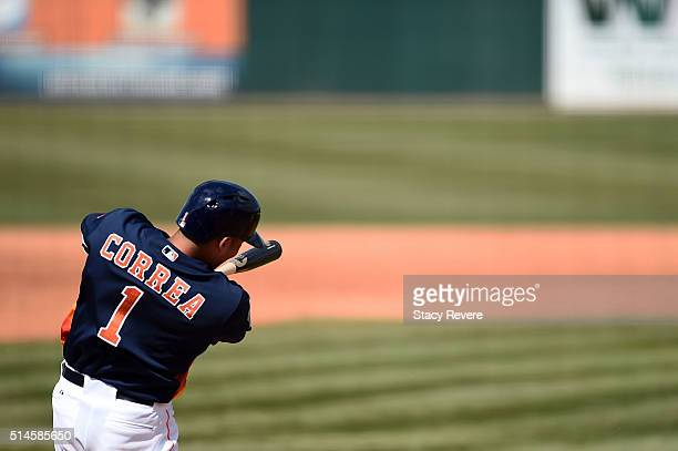 Carlos Correa of the Houston Astros swings at a pitch during a spring training game against the Atlanta Braves at Osceola County Stadium on March 9...
