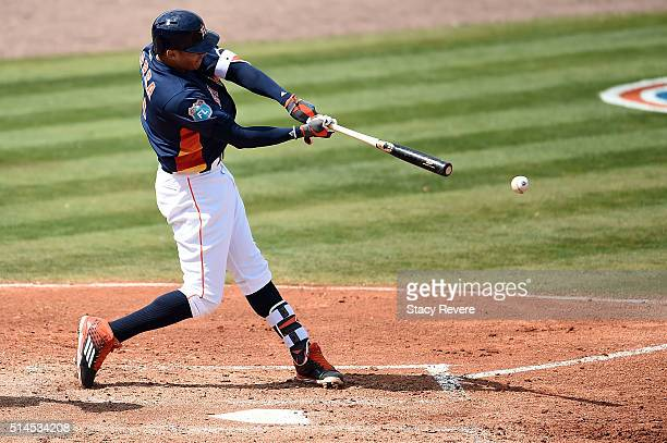 Carlos Correa of the Houston Astros swings at a pitch during the third inning of a spring training game against the Atlanta Braves at Osceola County...