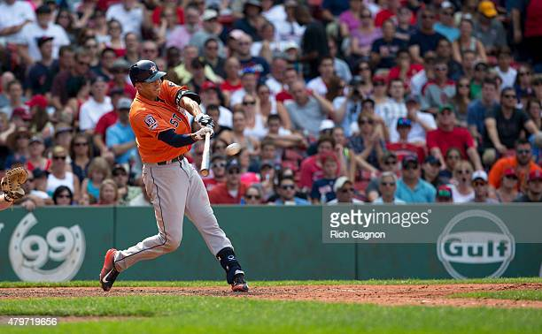 Carlos Correa of the Houston Astros swings at a pitch during the seventh inning against the Boston Red Sox at Fenway Park on July 5 2015 in Boston...