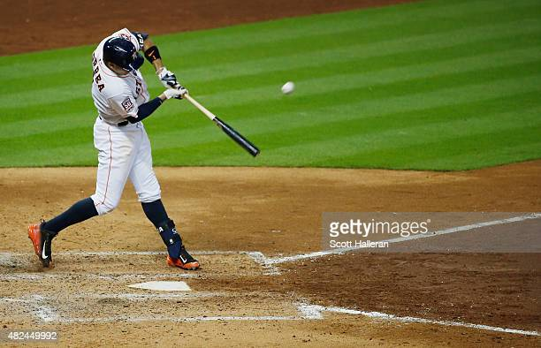 Carlos Correa of the Houston Astros swings at a pitch in the sixth inning against the Los Angeles Angels of Anaheim during their game at Minute Maid...