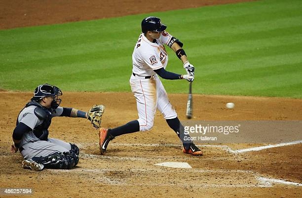 Carlos Correa of the Houston Astros swings at a pitch in the sixth inning of their game against the Seattle Mariners at Minute Maid Park on September...