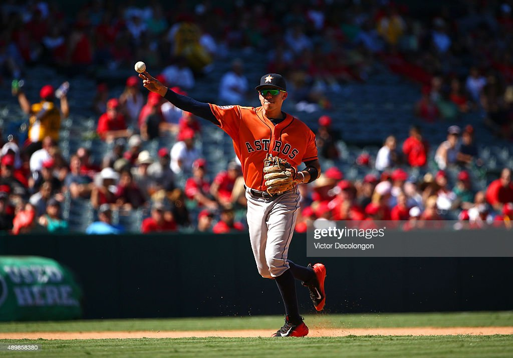 Carlos Correa #1 of the Houston Astros throws to first base in the seventh inning during the MLB game against the Los Angeles Angels of Anaheim at Angel Stadium of Anaheim on September 13, 2015 in Anaheim, California. The Astros defeated the Angels 5-3.