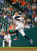 Carlos Correa of the Houston Astros throws to first base to retire Omar Infante of the Kansas City Royals in the seventh inning at Minute Maid Park...