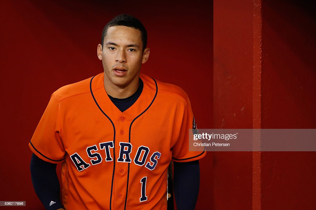 Carlos Correa #1 of the Houston Astros walks into the dugout before the MLB game against the Arizona Diamondbacks at Chase Field on May 31, 2016 in Phoenix, Arizona.