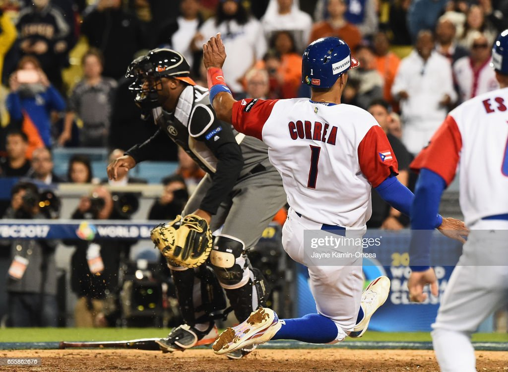 Carlos Correa #1 of the Puerto Rico scores the winning run against catcher Shawn Zarraga #37 of the Netherlands in the 11th inning during Game 1 of the Championship Round of the 2017 World Baseball Classic at Dodger Stadium on March 20, 2017 in Los Angeles, California. Puerto Rico won 4-3 in the 11th inning.