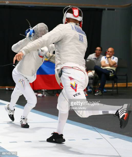 Carlos Correa Vila of Colombia attacks Abraham Rodriguez of Venezuela during the bronze medal match of the Team Men's Sabre event on June 18 2017 at...