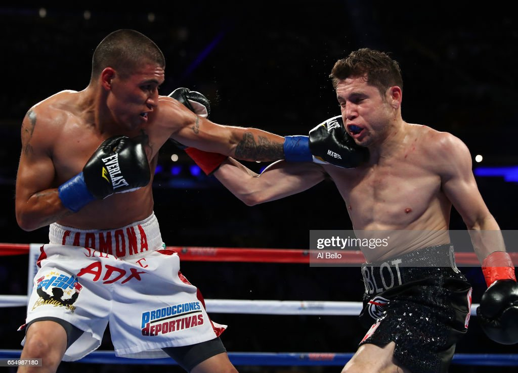 Carlos Cuadras and David Carmona exchange punches during their junior bantamweight bout at Madison Square Garden on March 18, 2017 in New York City.