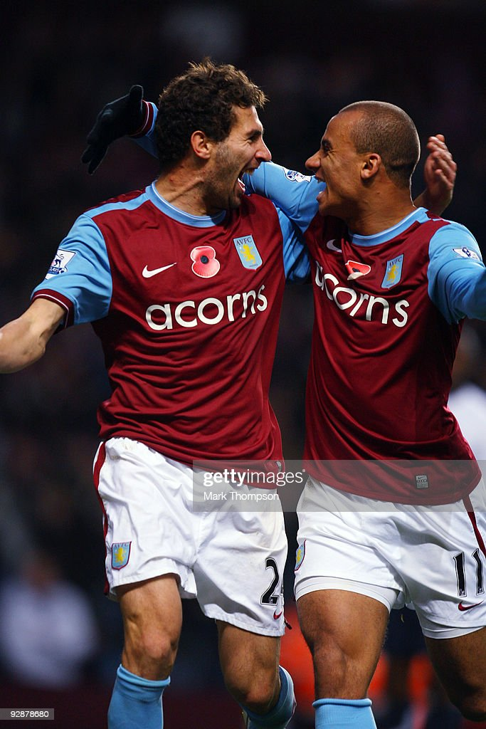 <a gi-track='captionPersonalityLinkClicked' href=/galleries/search?phrase=Carlos+Cuellar&family=editorial&specificpeople=2116627 ng-click='$event.stopPropagation()'>Carlos Cuellar</a> of Aston Villa celebrates his goal with team mate Gabriel Agbonlahore during the Barclays Premier League match between Aston Villa and Bolton Wanderers at Villa Park on November 7, 2009 in Birmingham, England.
