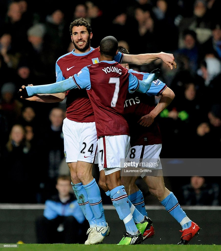 <a gi-track='captionPersonalityLinkClicked' href=/galleries/search?phrase=Carlos+Cuellar&family=editorial&specificpeople=2116627 ng-click='$event.stopPropagation()'>Carlos Cuellar</a> of Aston Villa celebrates the first goal during the Barclays Premier League match between Aston Villa and Manchester United at Villa Park on February 10, 2010 in Birmingham, England.