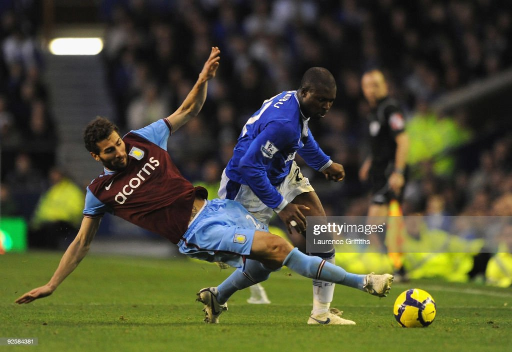 <a gi-track='captionPersonalityLinkClicked' href=/galleries/search?phrase=Carlos+Cuellar&family=editorial&specificpeople=2116627 ng-click='$event.stopPropagation()'>Carlos Cuellar</a> of Aston Villa tackles Yakubu of Everton for which he was sent off during the Barclays Premier League match between Everton and Aston Villa at Goodison Park on October 31, 2009 in Liverpool, England.